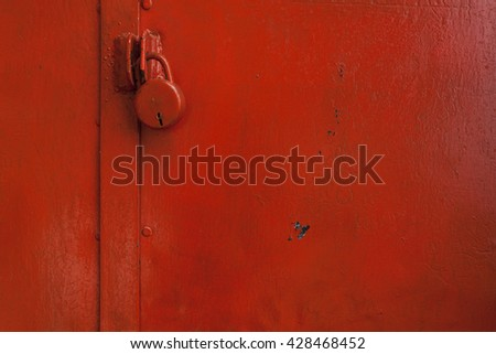 Painted door with red color with lock