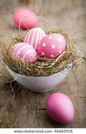 Painted easter egg in little bird nest - stock photo
