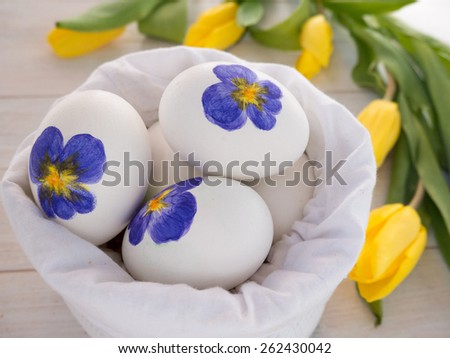 Painted Easter eggs in the white linen bag - stock photo