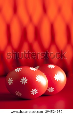 Painted Easter eggs on abstract background - stock photo