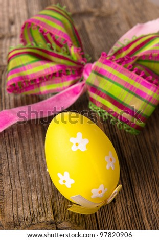 Painted Easter Eggs on wooden background - stock photo