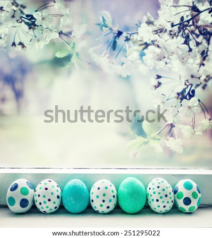 Painted Easter Eggs over spring garden background - stock photo