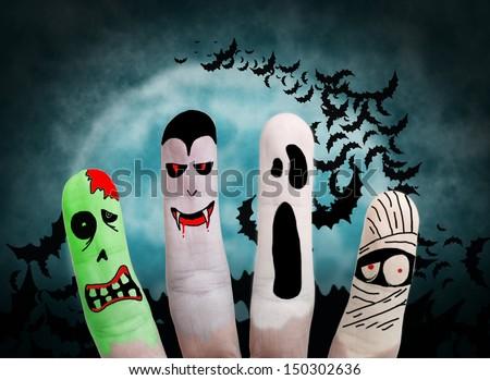 Painted finger monsters halloween: zombie, vampire, mummy, ghost - stock photo