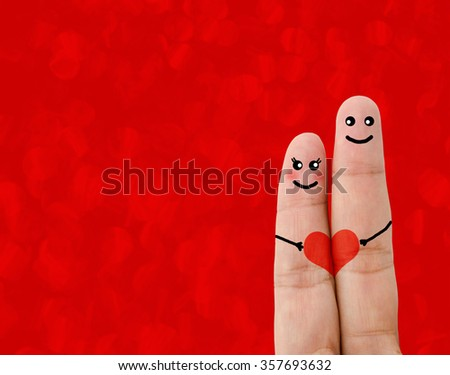 Painted finger smiley, valentine's day concept on red background. - stock photo
