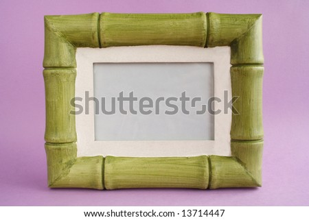 Painted frame in a bamboo style on color background - stock photo