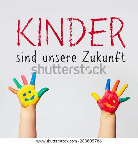 painted hands of little child - german for kids are our future - stock photo