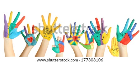 Painted hands with smile isolated on white - stock photo