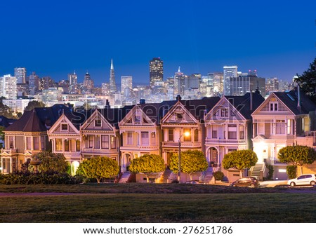 Painted Ladies houses and Downtown background from Alamo Square - stock photo