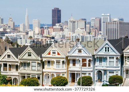 Painted Ladies in San Francisco. It is the row of Victorian houses across Alamo Square park. - stock photo