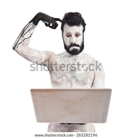Painted man with laptop - stock photo