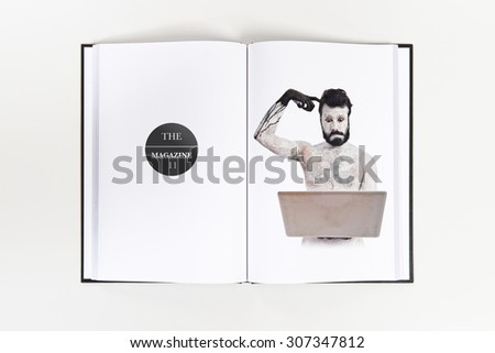 Painted man with laptop printed on book - stock photo