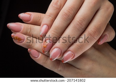 painted nails and hands isolated on black background