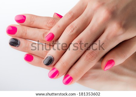 Painted pink black nails and hands isolated on white background - stock photo