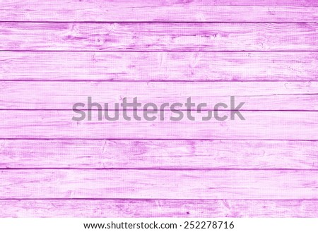Painted Plain Red Pink Rustic Wood Board Background that can be horizontal or vertical. Blank Room or Space area for copy, text,  your words, above looking down view. Tinted photo. - stock photo