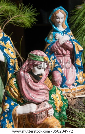 Painted pottery statue portraying one of the three wise men, work by a ceramic artisan in Caltagirone - stock photo