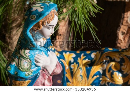 Painted pottery statue portraying the virgin Mary in the ceramic nativity scene of an artisan in Caltagirone - stock photo