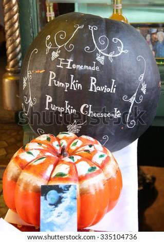 Painted pumpkin at Italian restaurant in historic Little Italy in lower Manhattan.  - stock photo