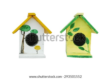 Painted two birdhouses isolated on white - stock photo