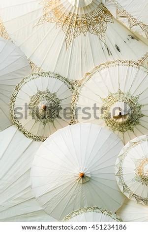 Painted umbrellas in a handicraft village in Thailand - stock photo