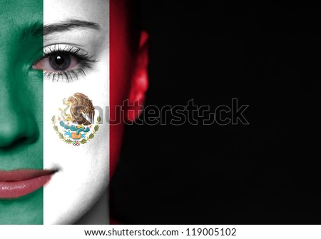 Painted woman face with flag of Mexico - stock photo