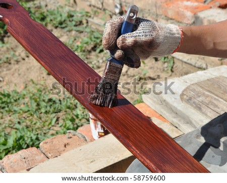 painted wooden surface with a brush - stock photo