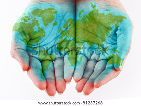 Painted world on hands. Isolated on a white background - stock photo