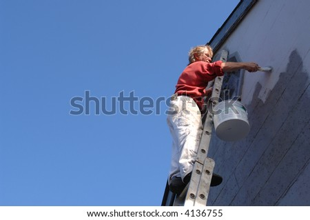 Painter against clear blue sky - stock photo