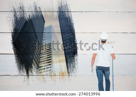 Painter against low angle view of skyscrapers - stock photo