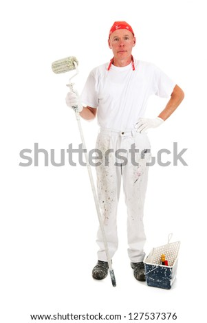 Painter for painting the wall with a big roller - stock photo