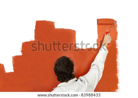 Painter, painting a wall with a paint roller in the shape of a bar graph