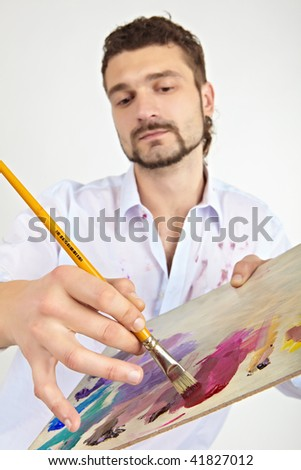 Painter with brush and palette - stock photo
