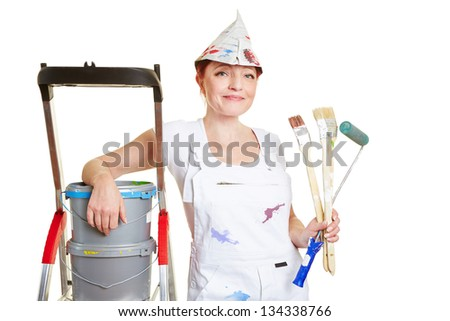 Painter with brushes and paint buckets and ladder - stock photo