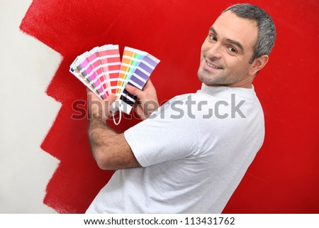 Painter with color samples - stock photo
