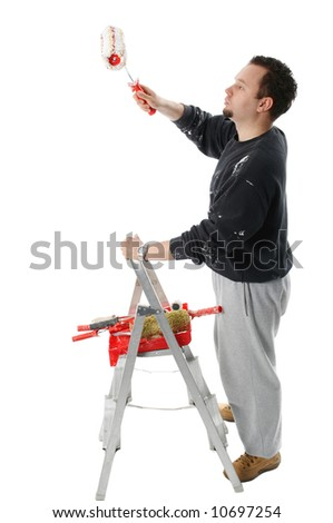Painter with ladder holding a paint roller - stock photo