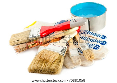 Painter working tools. Set of paint bucket with blue paint, gloves and paintbrushes for decoration - stock photo