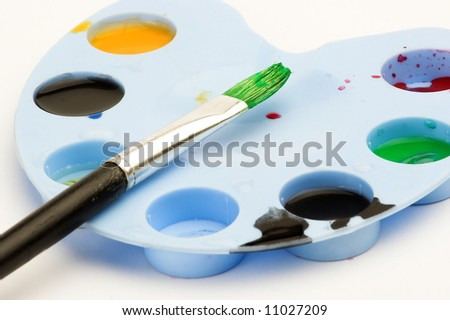 Painter workplace,paints and brushes close up