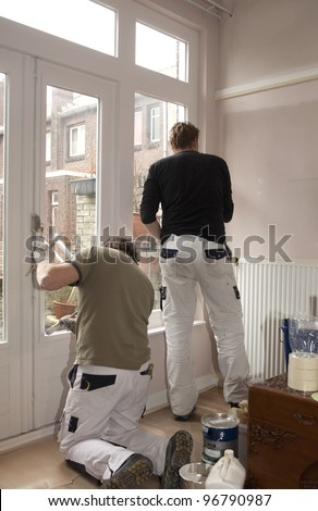 Painters at work inside a home