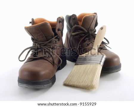 painters boots and brush on the white background - stock photo