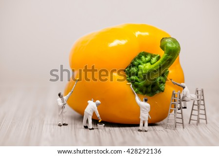 Painters coloring bell pepper. Macro photo. - stock photo