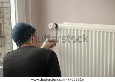 Painting a radiator in concentration