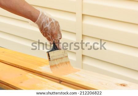 Painting bare wood  - stock photo