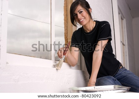 Painting Beauty Brunette Housewife Home Decor Project Using Paint Brush White - stock photo