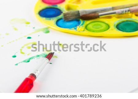 Painting brush with paint and watercolor paint  - stock photo