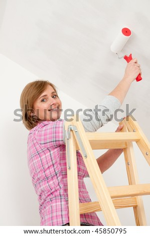 Painting by roller - stock photo