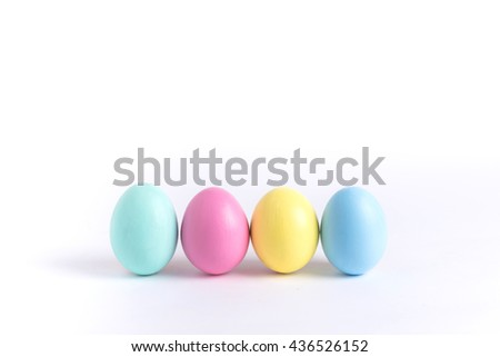 painting colorful pastel easter eggs - stock photo