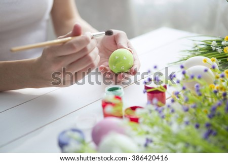 Painting Easter eggs. Painting eggs for easter holiday celebration. Happy easter