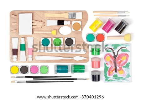 painting equipment: brushes, palette and paints on white background  - stock photo