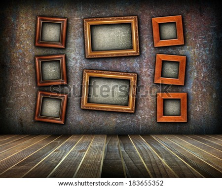 painting frames with blank canvas on abstract grungy interior backdrop with place for your text or message - stock photo