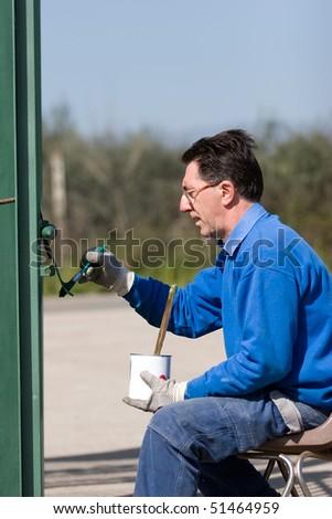 painting gate - stock photo