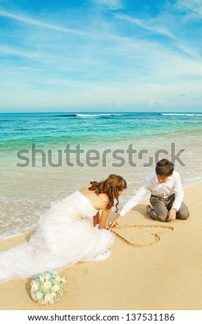 painting heart on the sand - stock photo